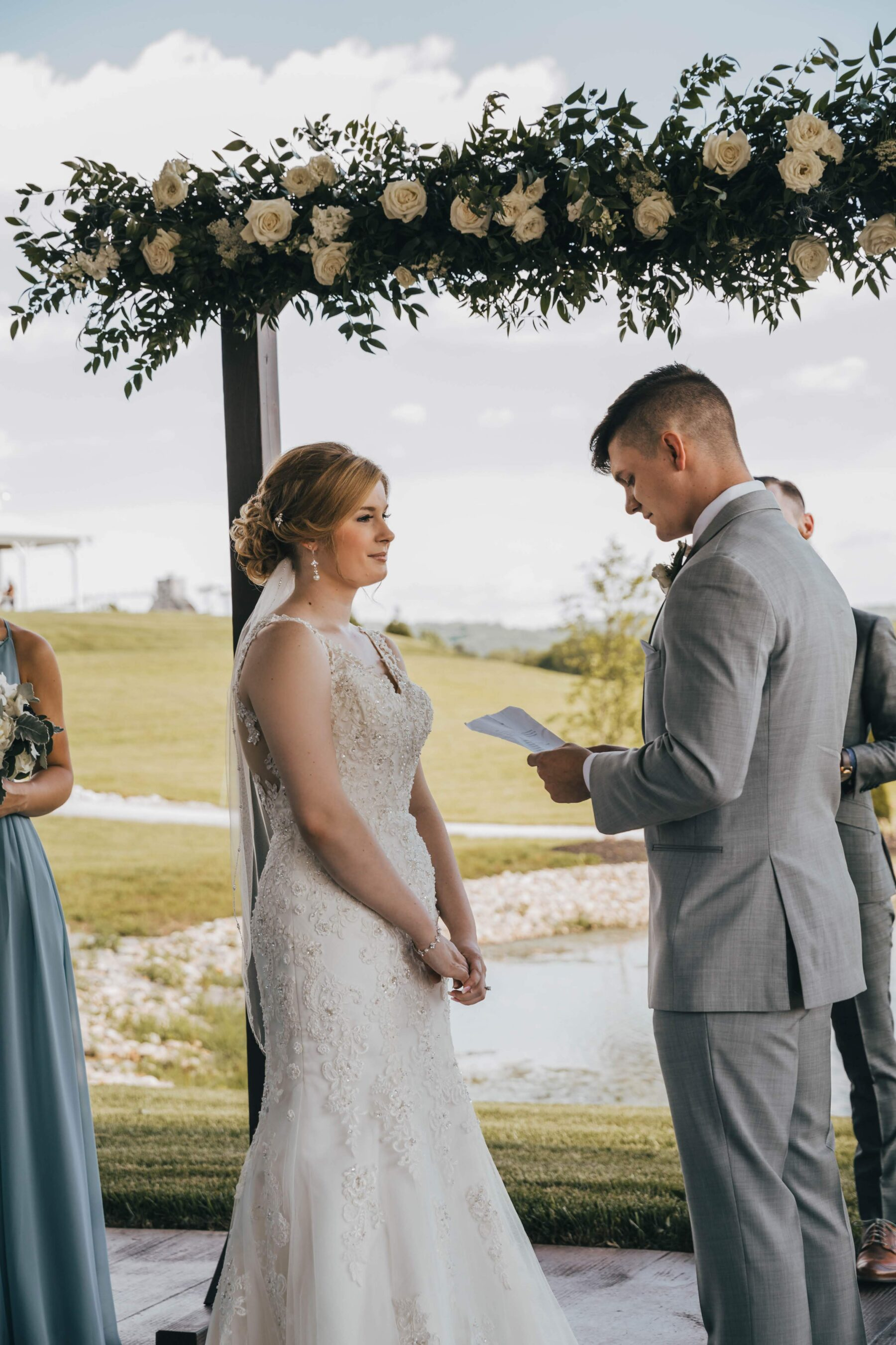 Wedding vow exchange: White Dove Barn Wedding by Grace Upon Grace Photography featured on Nashville Bride Guide