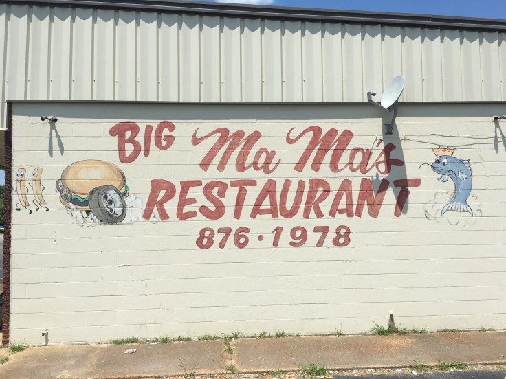 Restaurant sign with food street art Nashville
