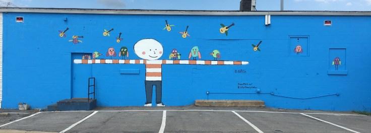 Birds & man mural street art Nashville