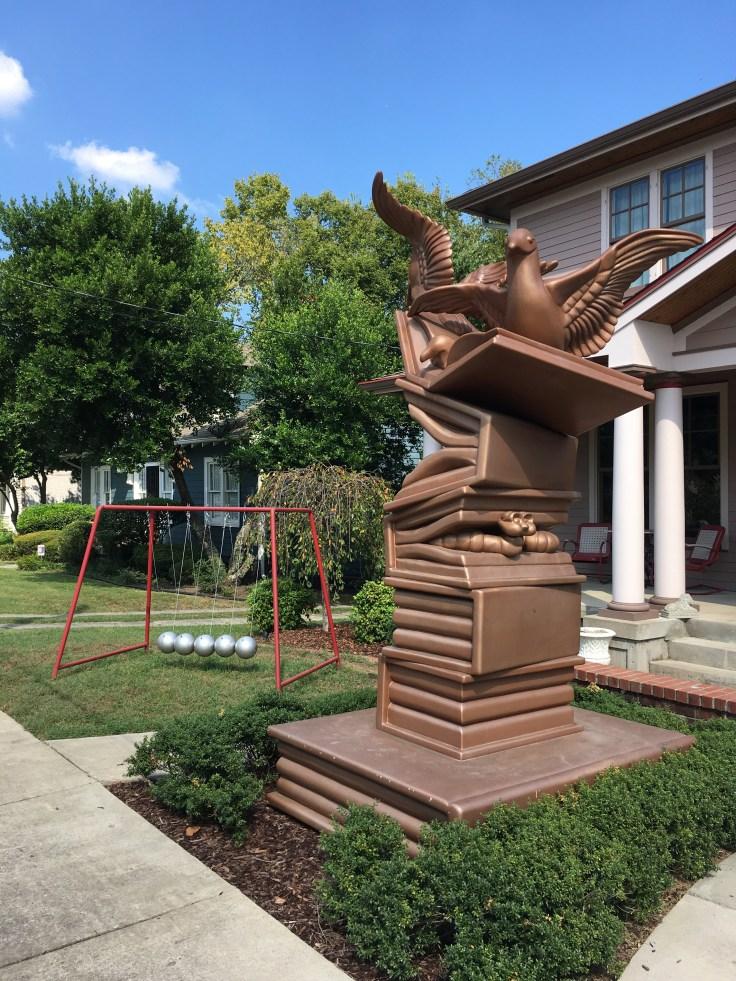 Bird & Books statue street art Nashville