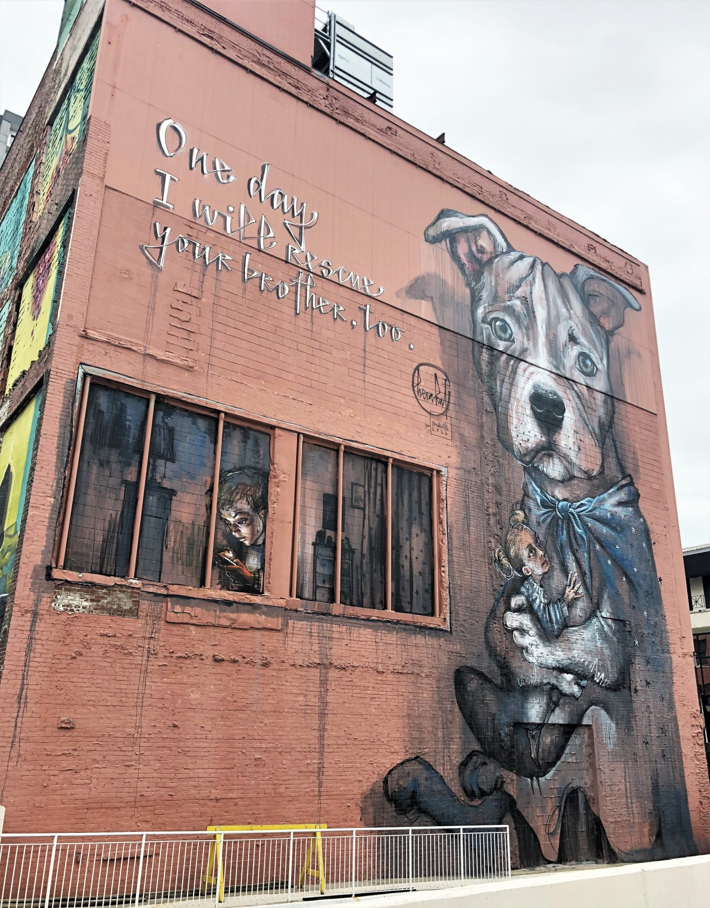 Dog child mural street art Nashville