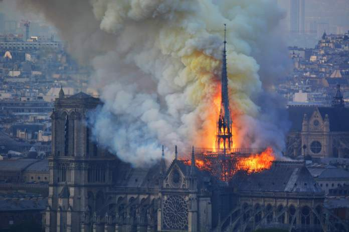 Notre Dame Cathedral on fire. Photograph: Hubert Hitier/AFP/Getty Images