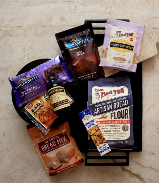 baking staples, bread mix, Bob's red mill flower, Ghirardelli cocoa, active dry yeast, vanilla extract, almond paste, baking powder