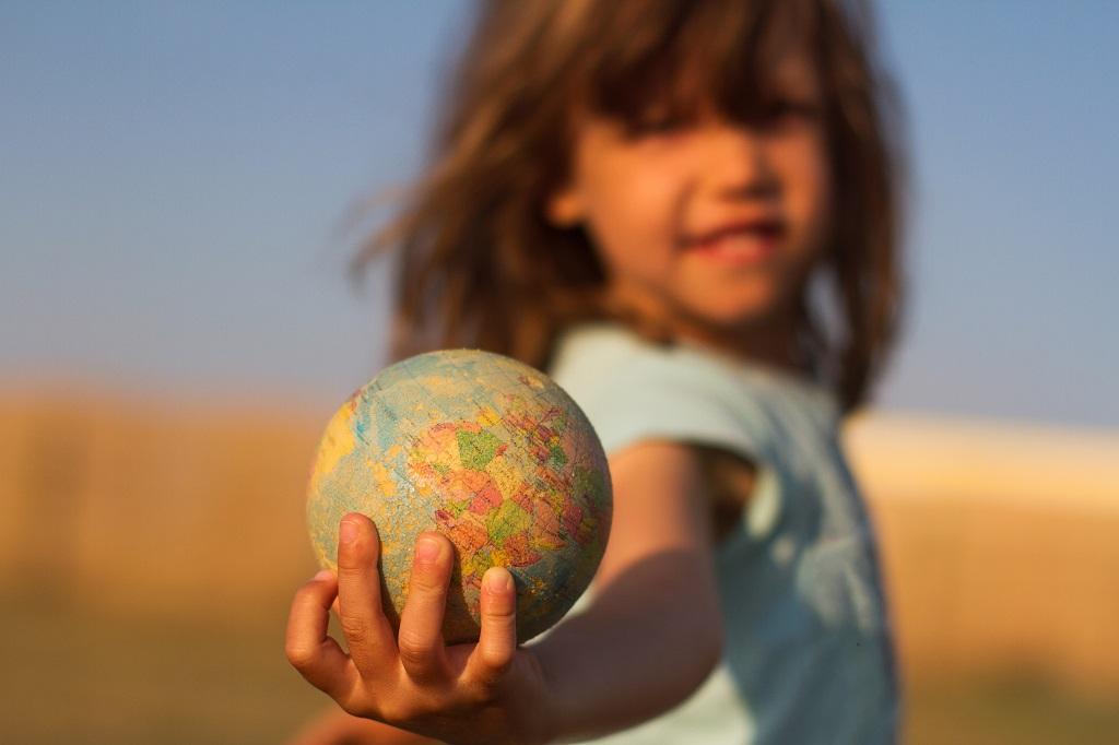hand holding an earth