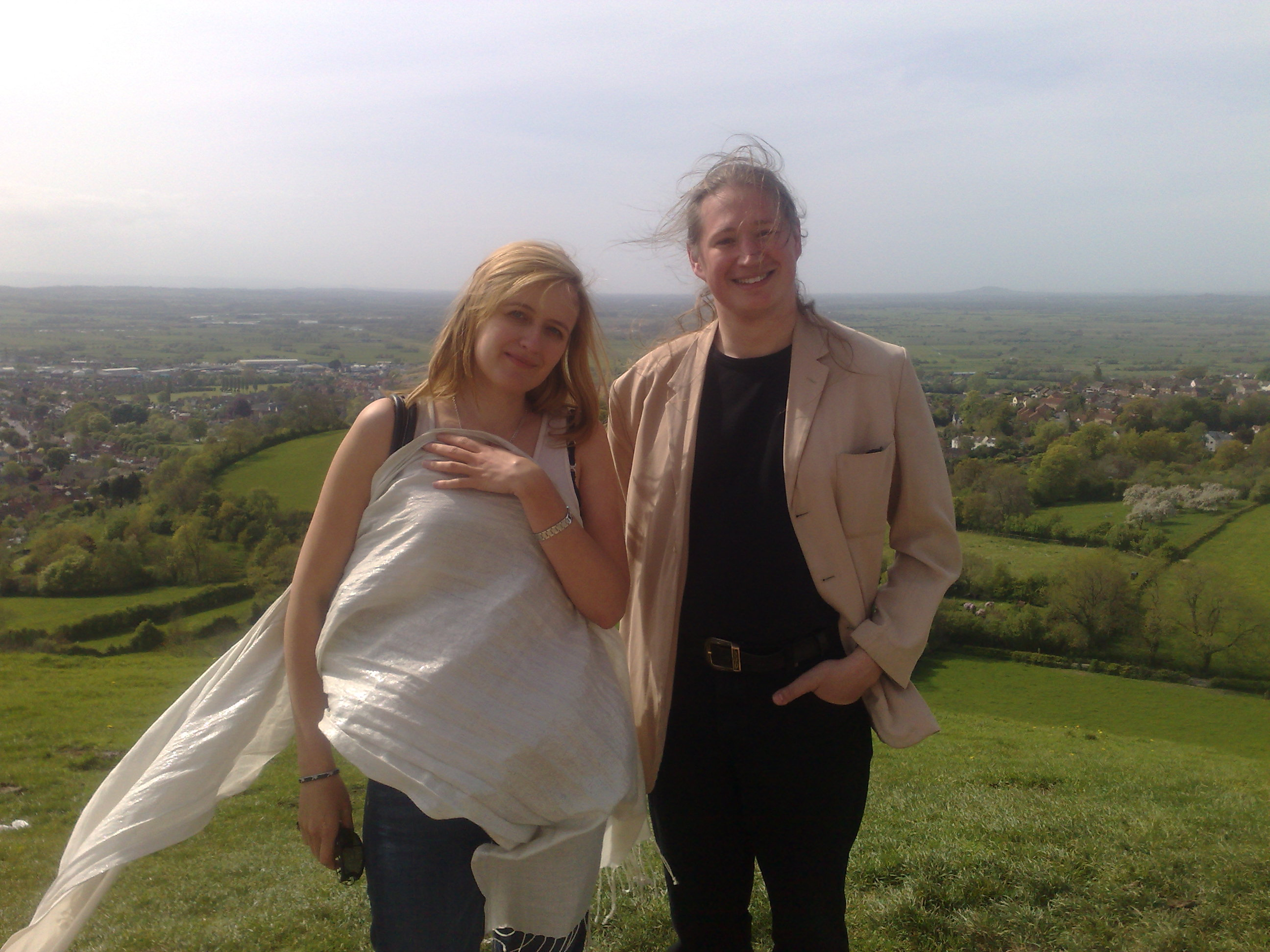 We pose for a historic photo on top of the magical hill - documenting that the twain have met, and are now considering a stroll down to Glastonbury for some ale