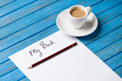 pencil and paper with inscription r cup of coffee