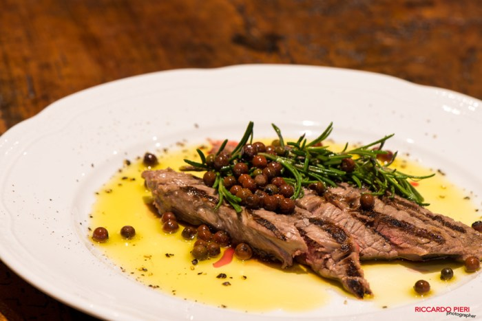 Sliced beef {tagliata} with rosemary and pink pepper - very tasty and aromatic