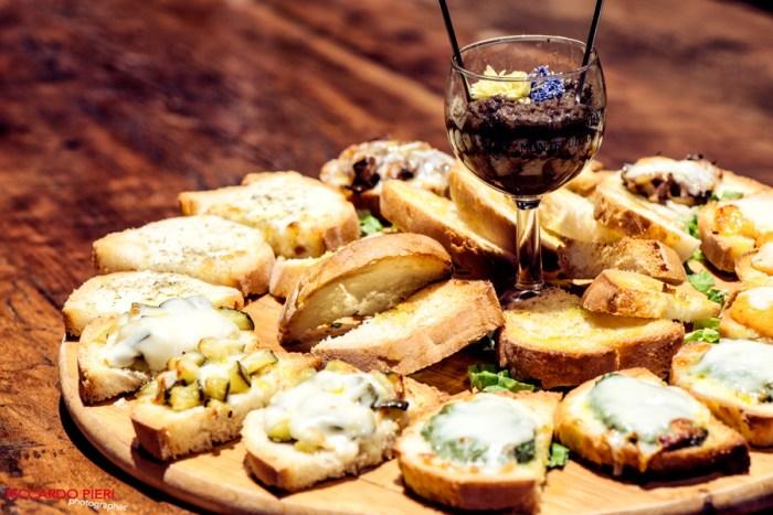 an assortedBruschetta plate withmelted cheese,salsa verde, savory liver pâté