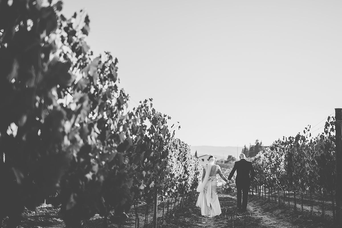 Strolling through Tuscan vineyards- couples goals wedding photos