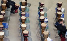 TORONTO, ON – FEBRUARY 26 – African drums line up on chairs for the African drumming workshop. Happening in the student centre at Humber College, the first 50 students were eligible to play their own drum. This event was part of Black History Month. It was meant to be a commemoration to Madiba presented by master drummer Babarinde (Baba) Williams.