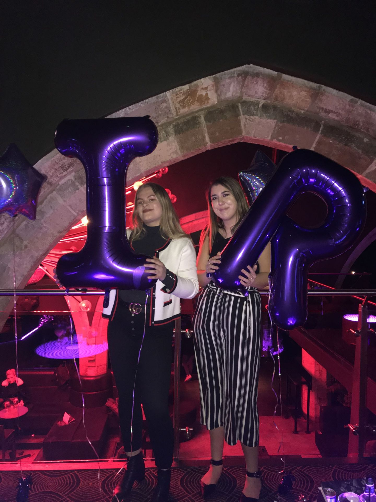 Abbi and I holding purple I&R balloons at Jalou York