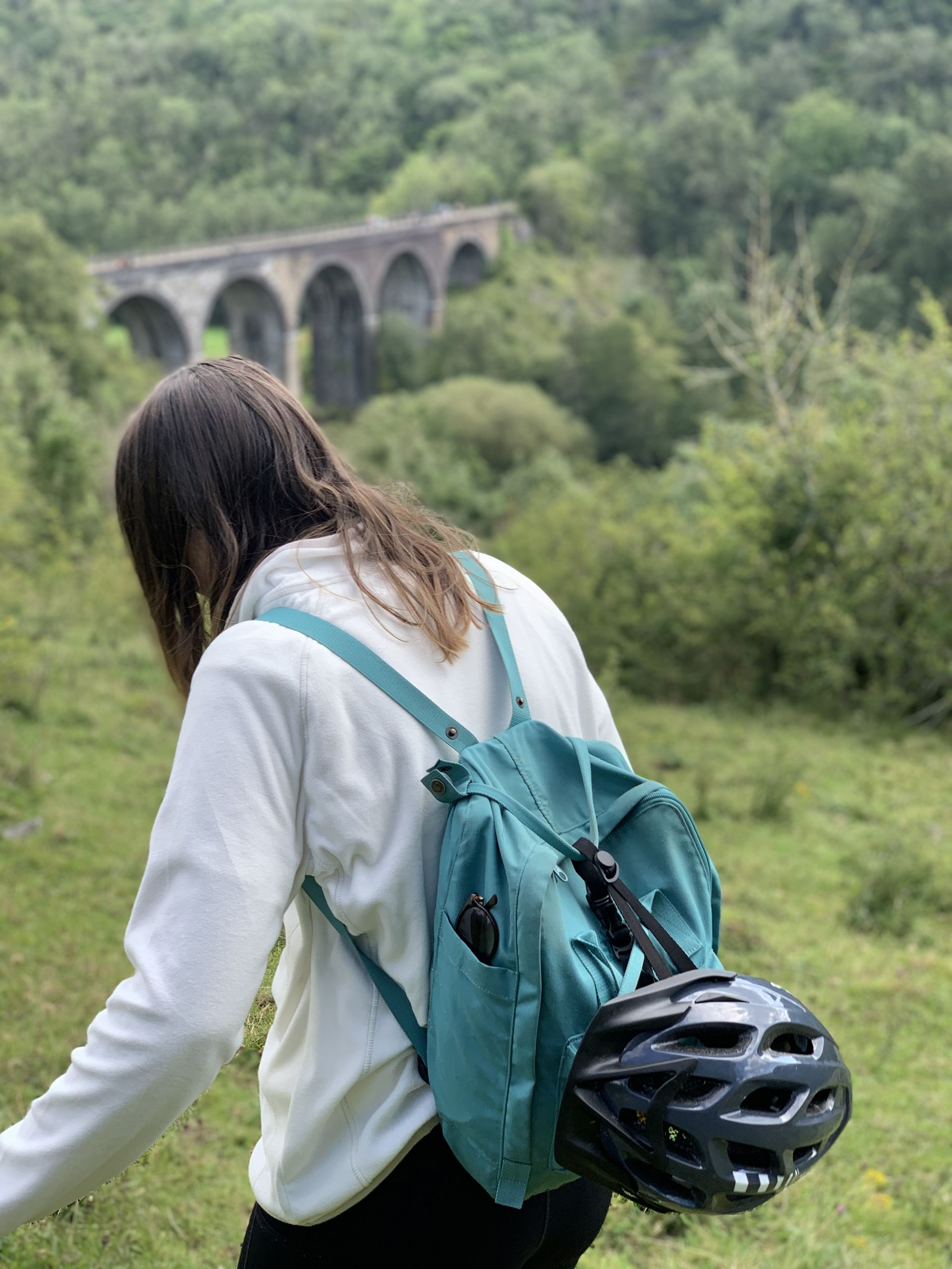 stood with my back to the camera in front of monsal viaduct