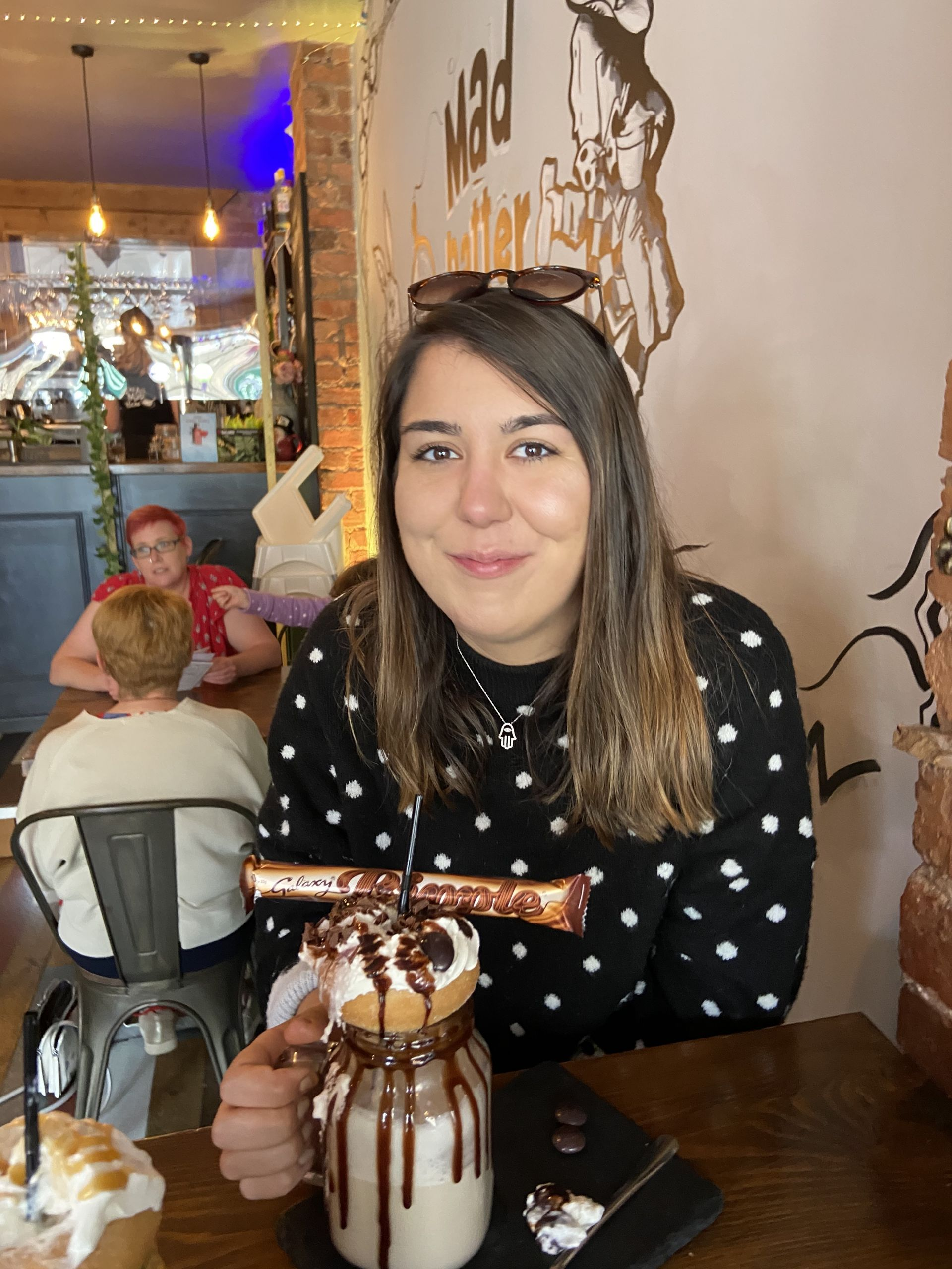 me sat with a freakshake in the Mad Hatter's Cafe in Matlock, in the Peak District