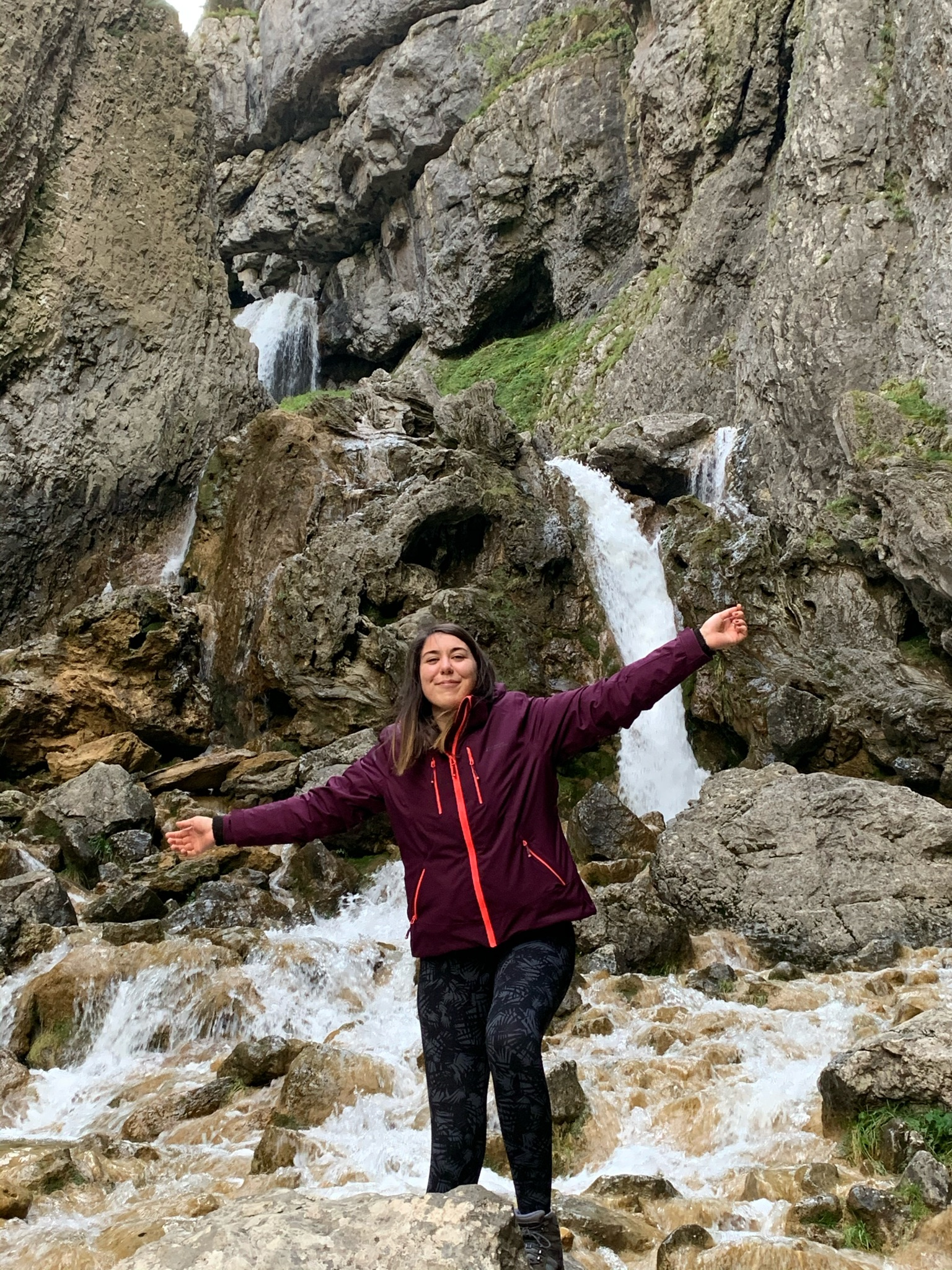 Me stood in front of Gordale Scar waterfall with my arms in the air
