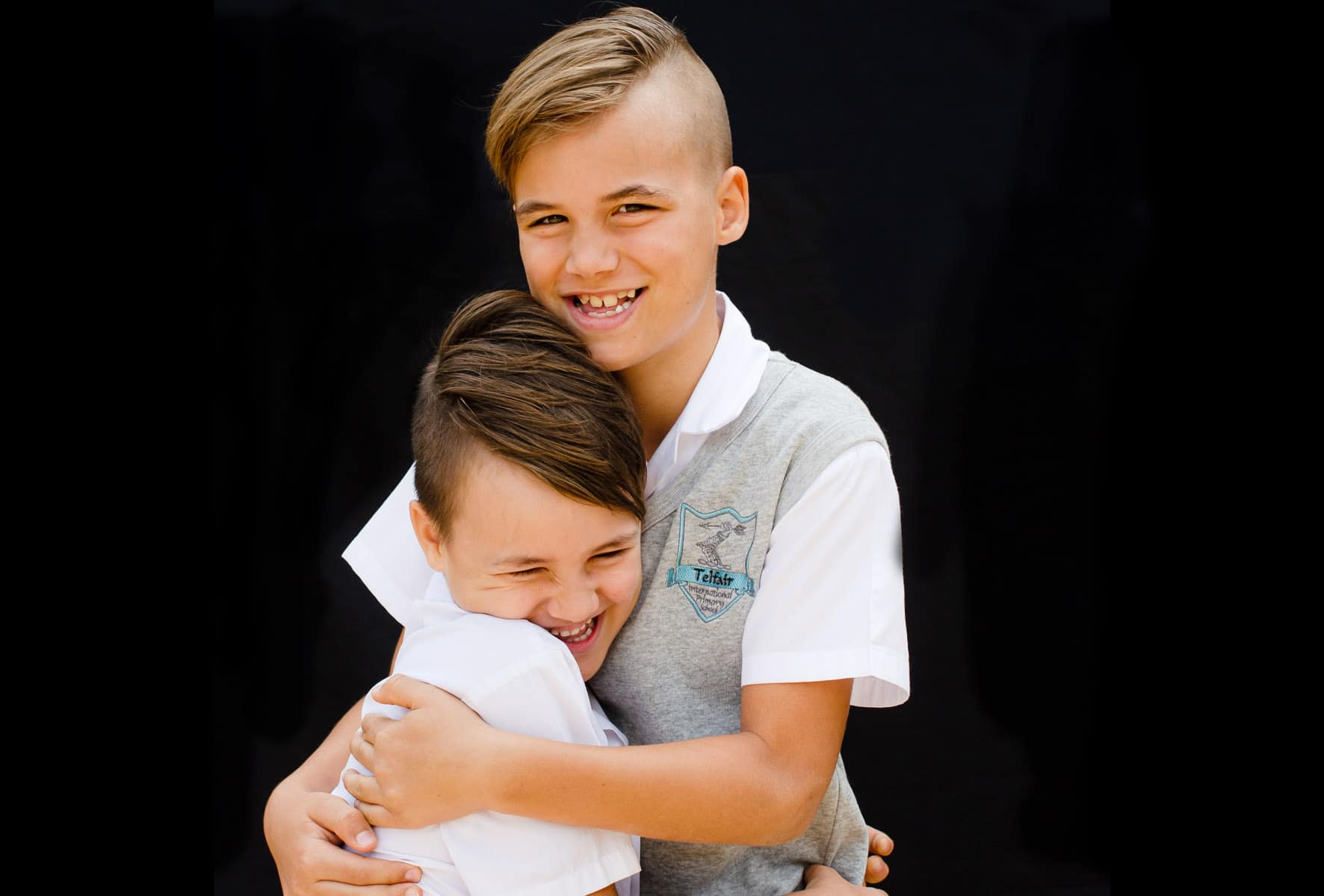 school sibling photo of brothers in their uniform