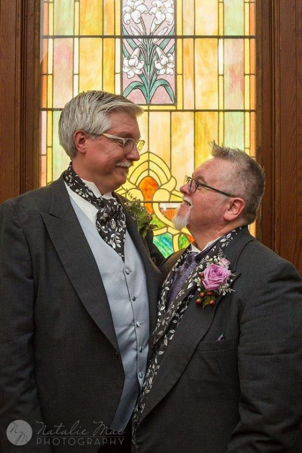 Same sex wedding photographer captures grooms looking into each other's eyes after their wedding