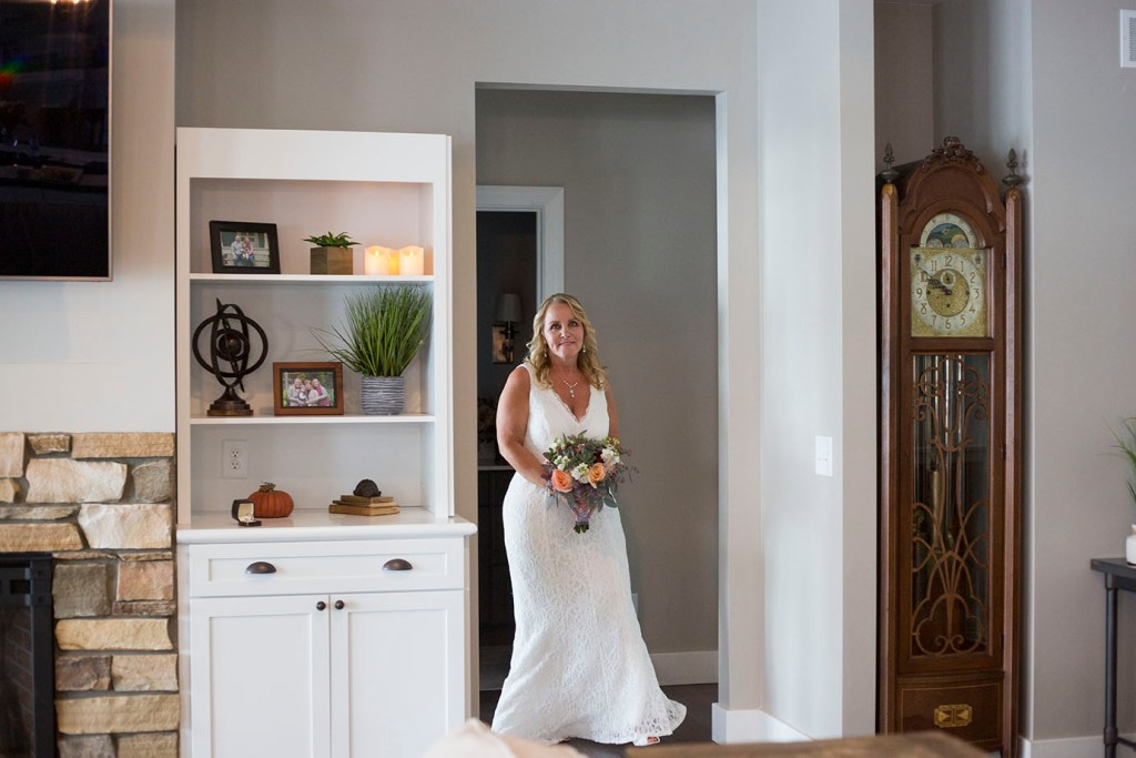 Bride walks around the corner to see her groom for the first time on their wedding day