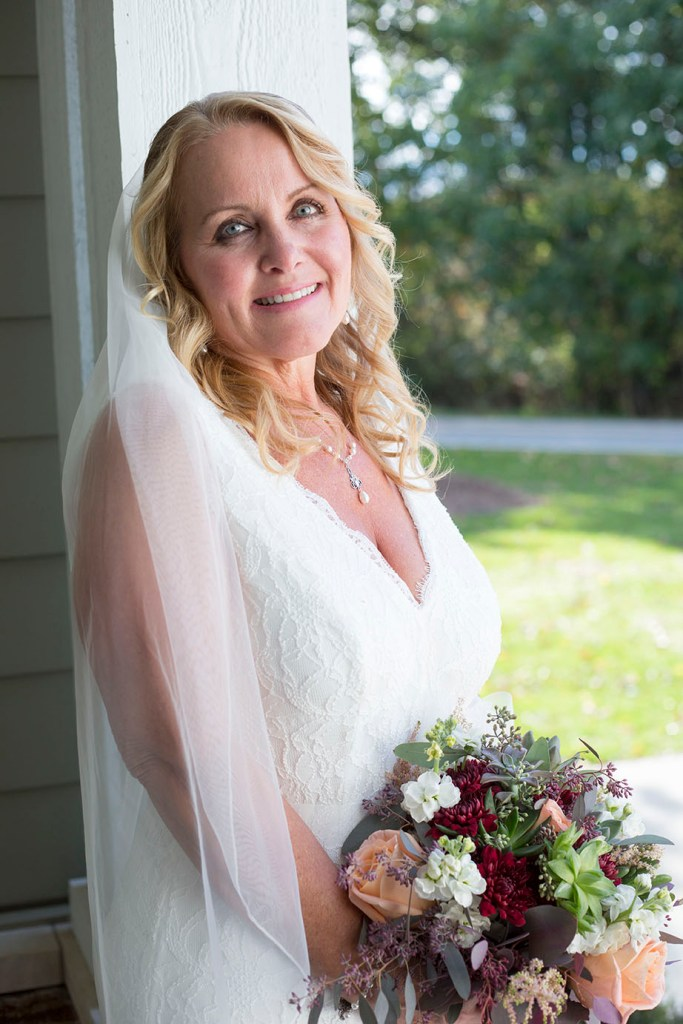 Stunning bride beaming after eloping