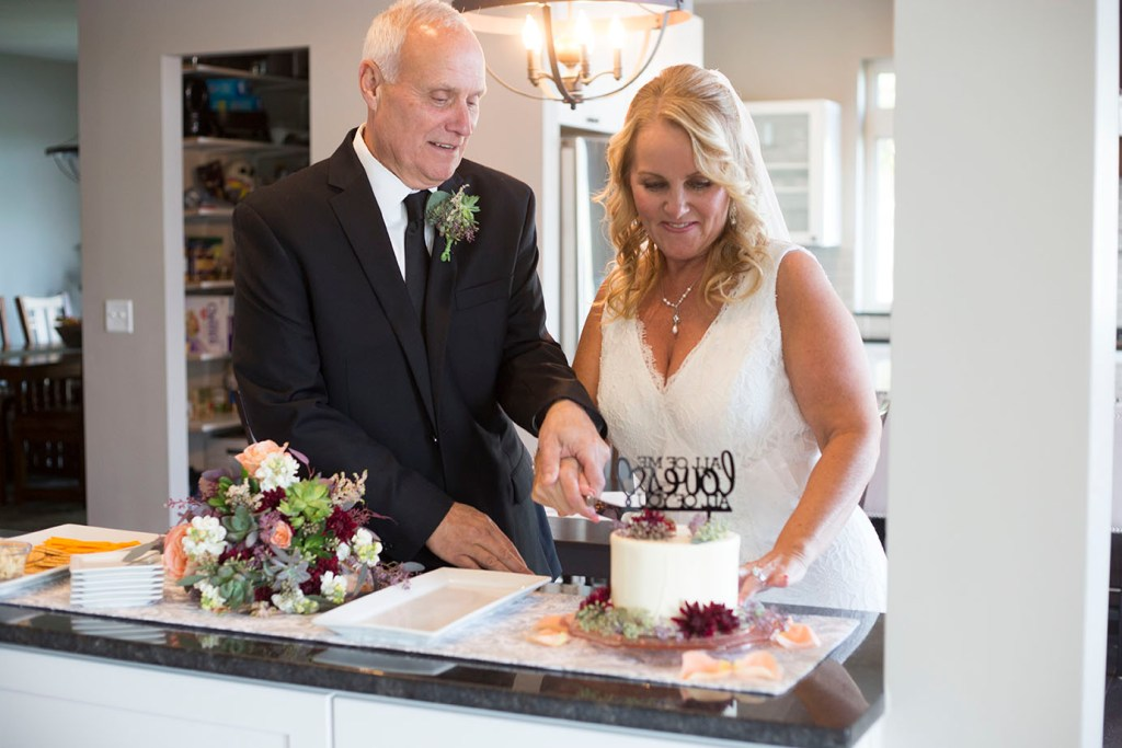 Cutting of the cake after their Chelsea Michigan elopement