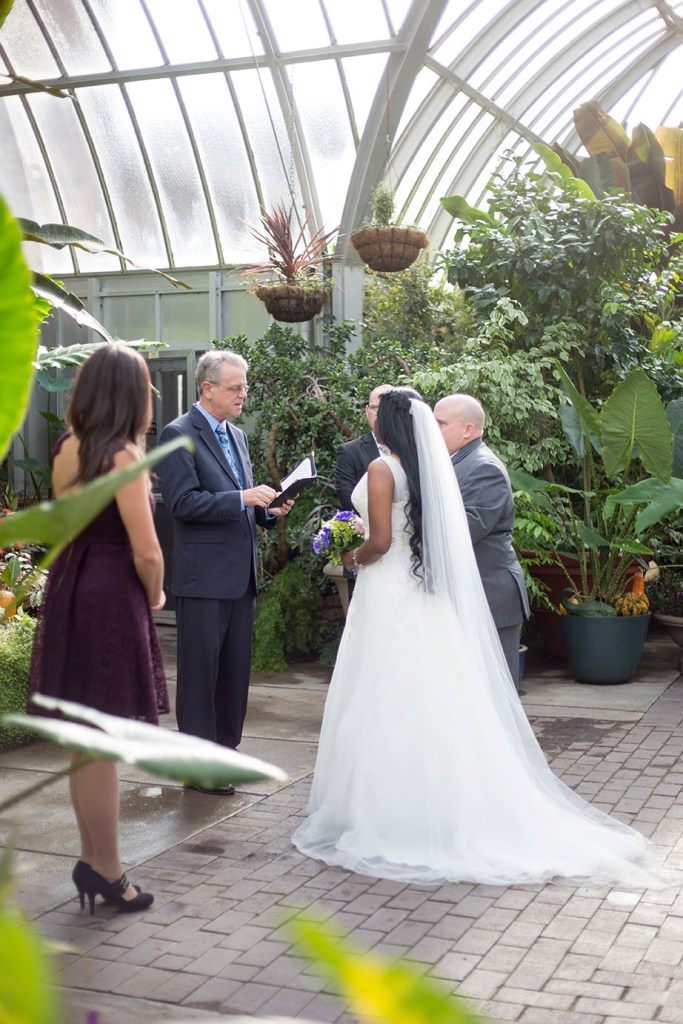 Couple stands in front of the officiant at their Belle Isle wedding