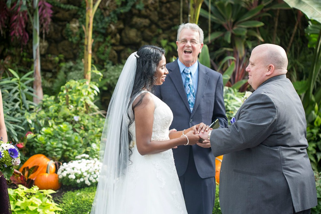 Officiant sharing some laughs during the Belle Isle wedding ceremony