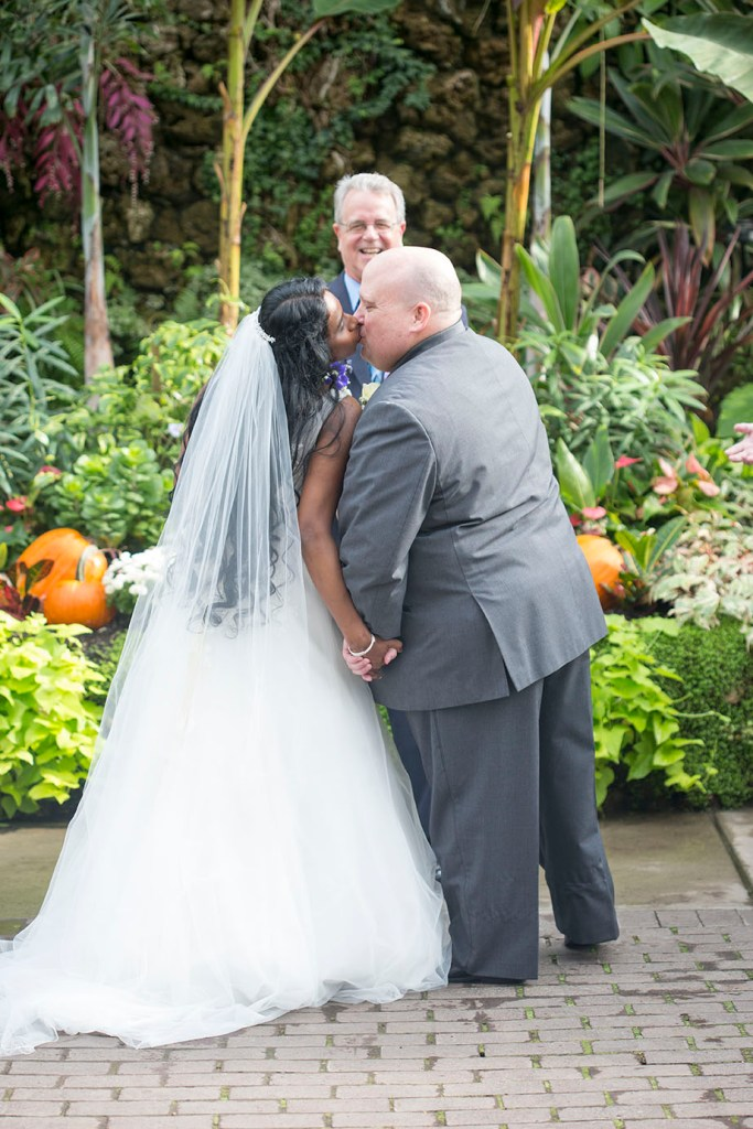 First kiss between husband and wife at their Belle Isle wedding