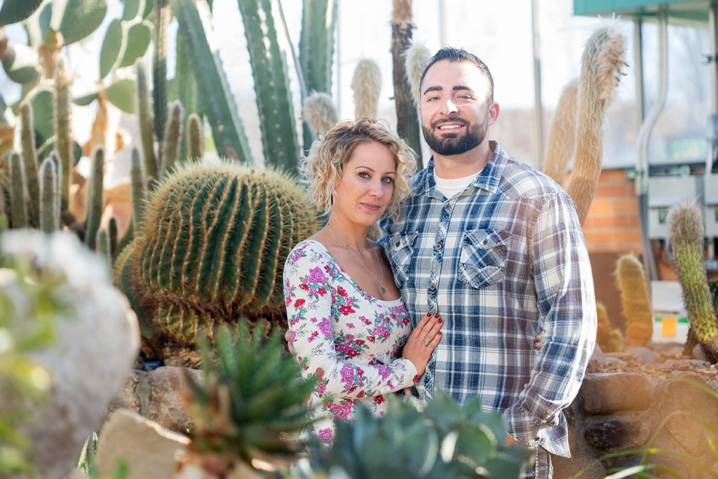 Clint and Meggie cuddle among the cactuses at Matthaei Botanical Gardens