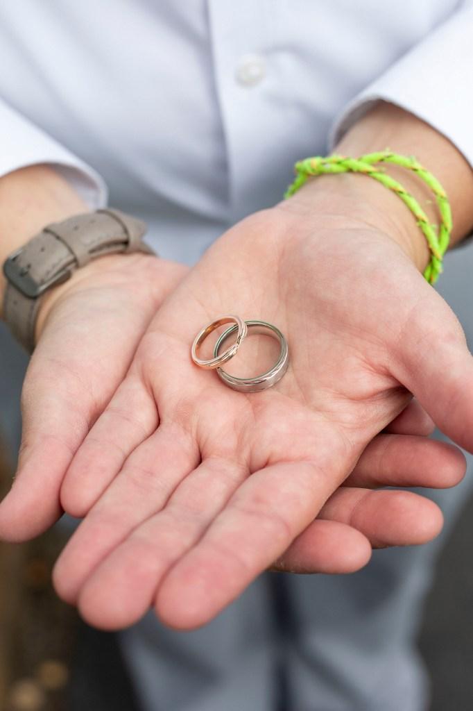 Wedding rings in bride's hands
