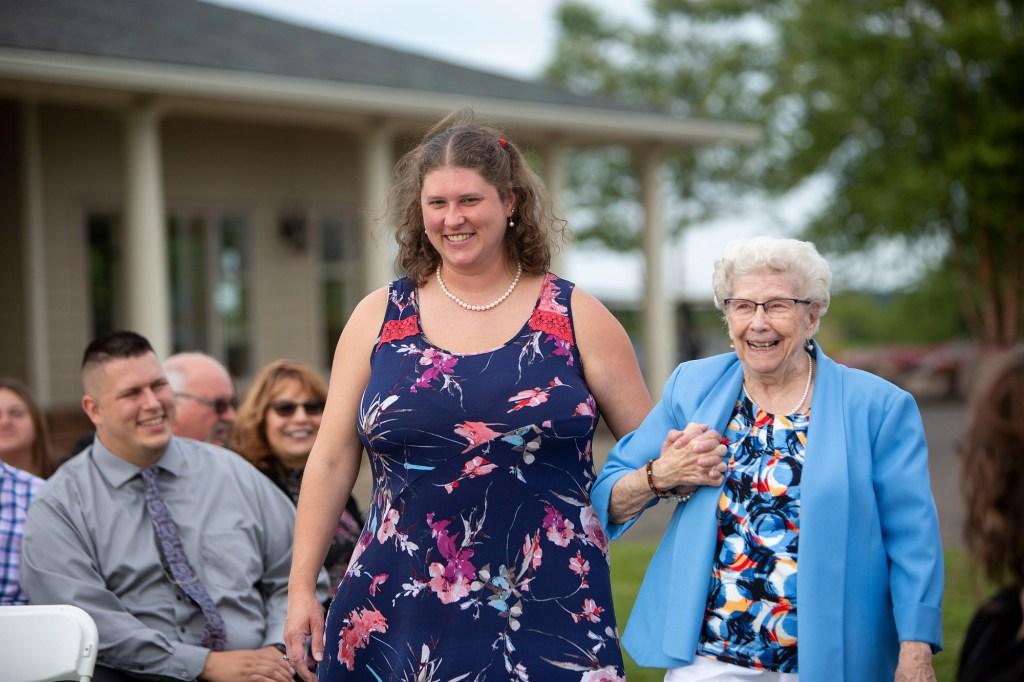 Grandma getting escorted to her seat
