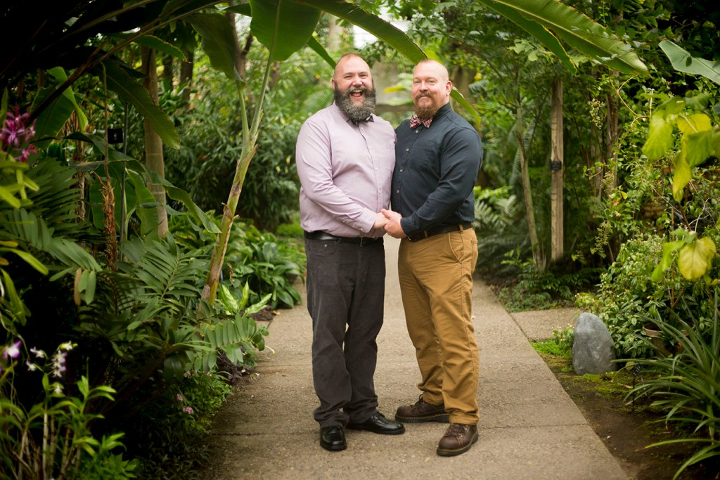 Michigan wedding couple inside the Tropical House at Matthaei Botanical Gardens
