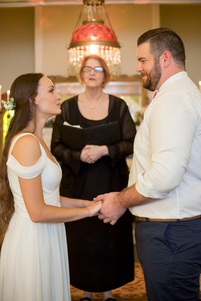 Couple holding hands while exchanging their vows