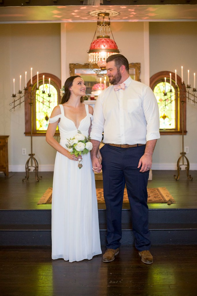 Couple looks at each other with hearts filled after their wedding
