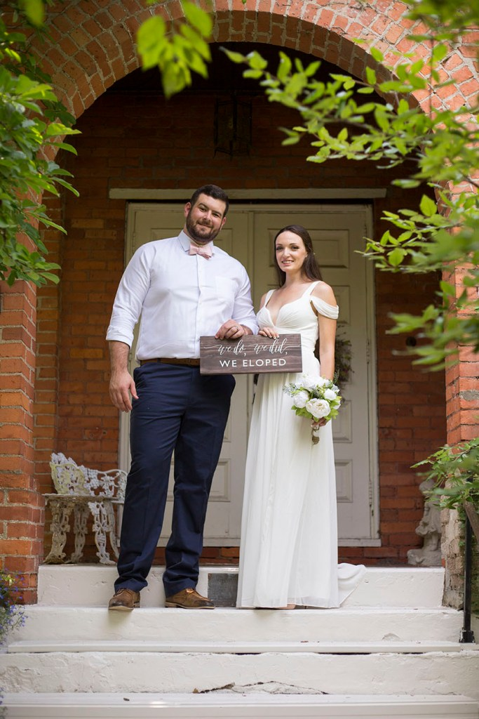 Couple on steps of Celebrations Wedding Chapel