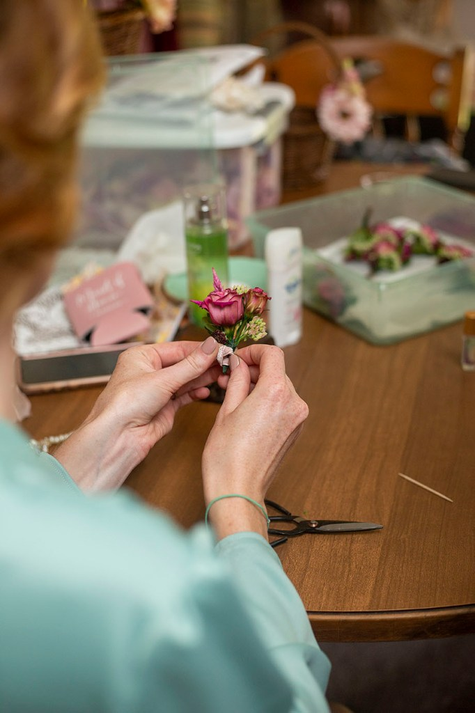 Finishing touches on Belleville wedding boutonnieres