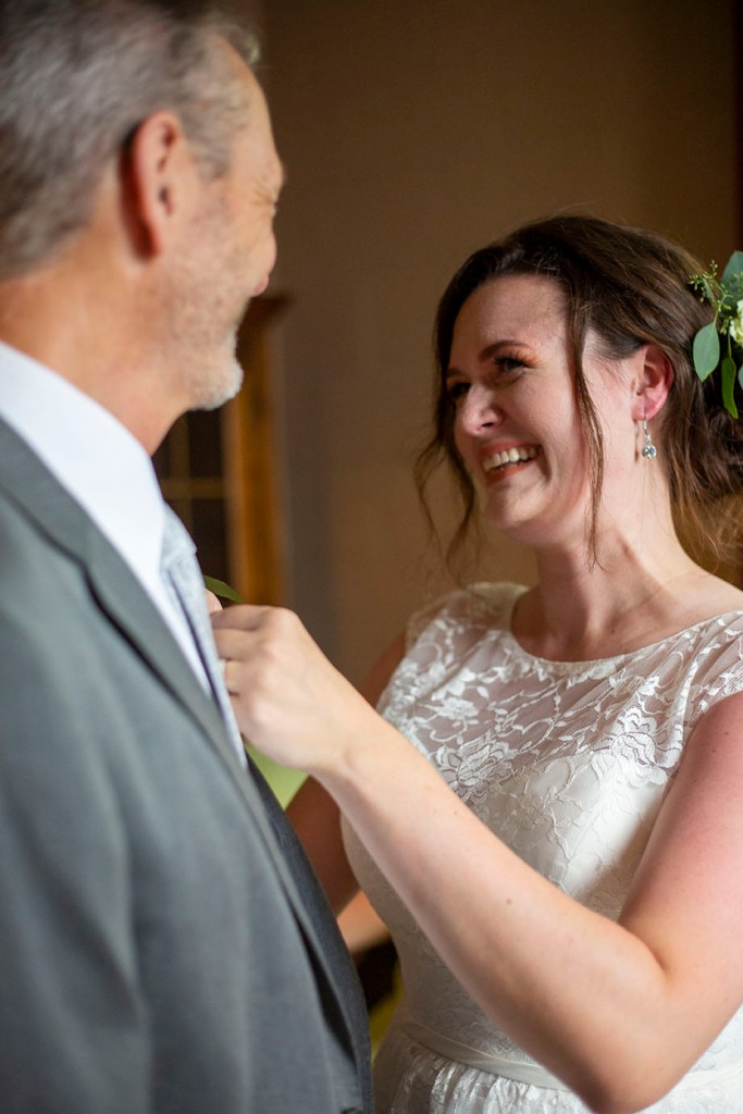 Rachel smiling at her dad before her Northville wedding