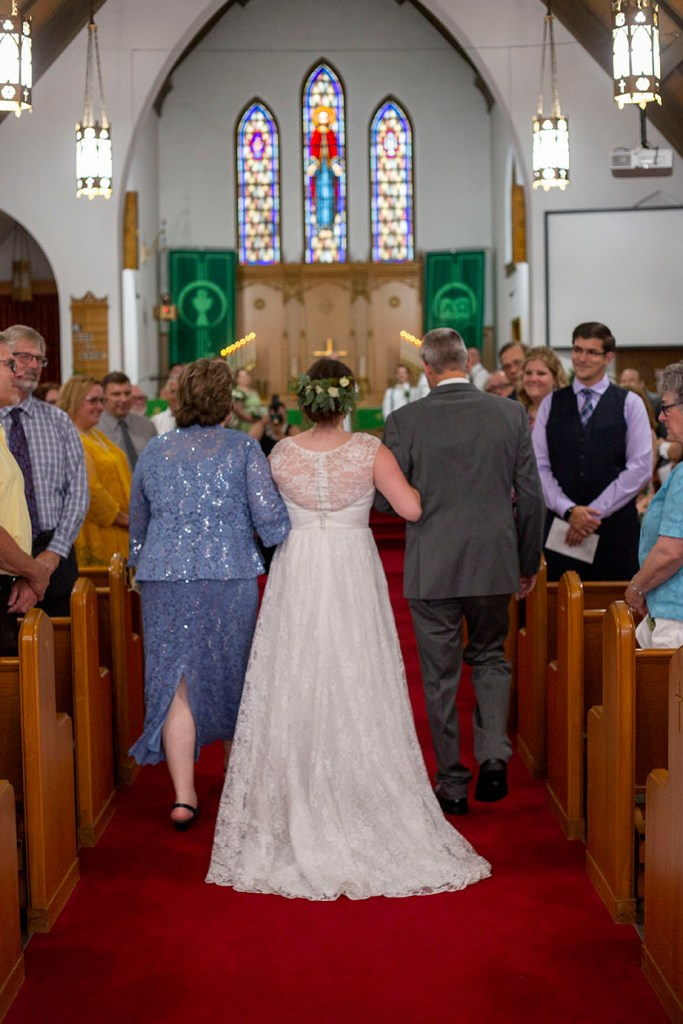 Northville bride walking down the aisle with her parents