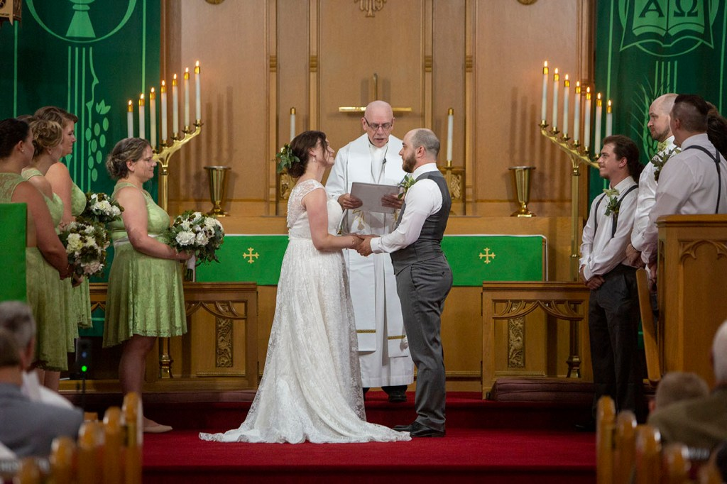 Couple at the altar of their Northville wedding