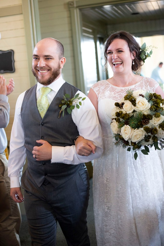 Couple's grand entrance to their wedding reception