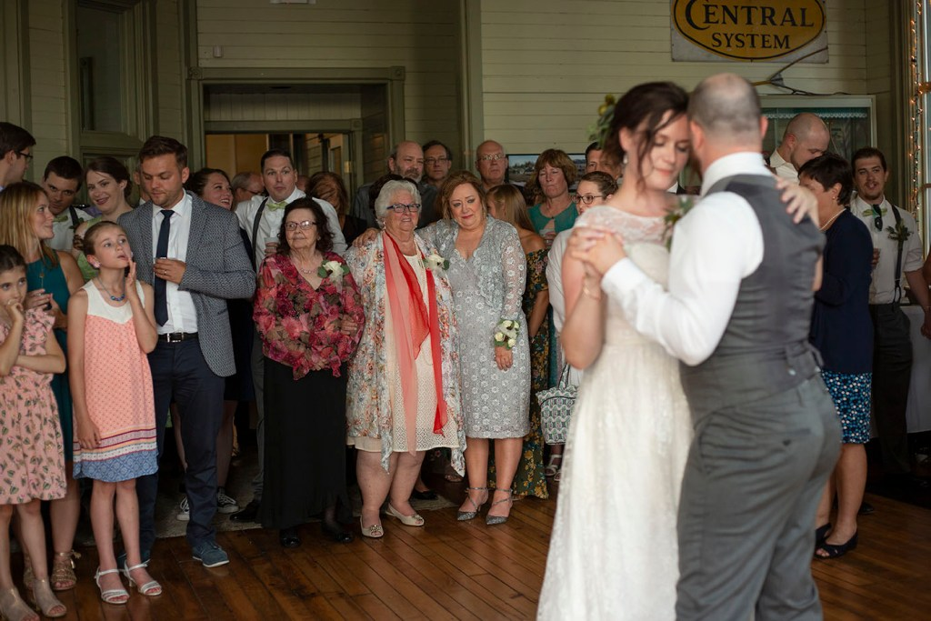 Mother and grandmother watch son's first dance as a married man