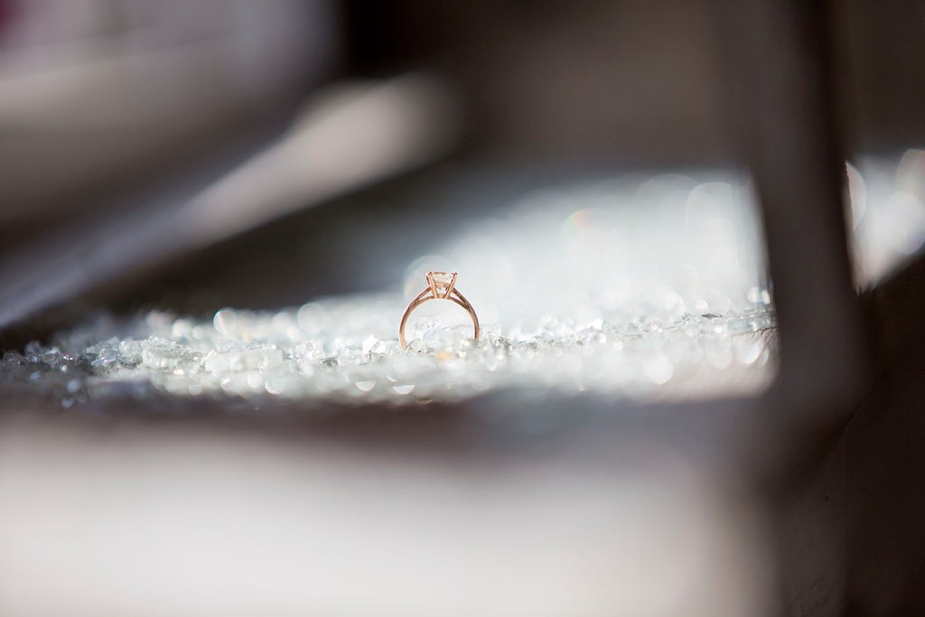 Engagement ring amongst shattered glass in abandoned building