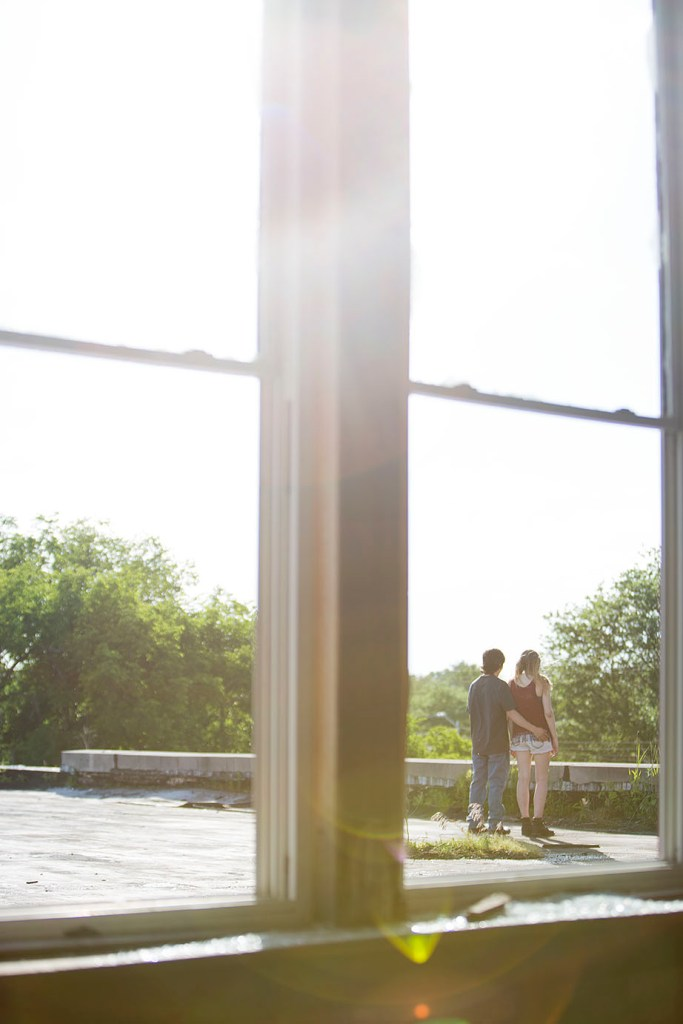 Couple walks on roof for their Detroit urbex engagement session