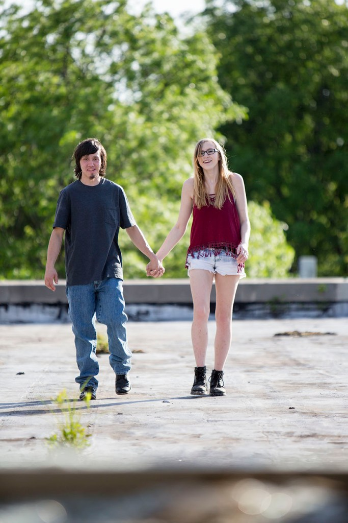 Brandon and Claire walking hand in hand
