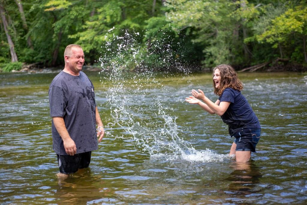 Lola splashing Chris in the Huron River