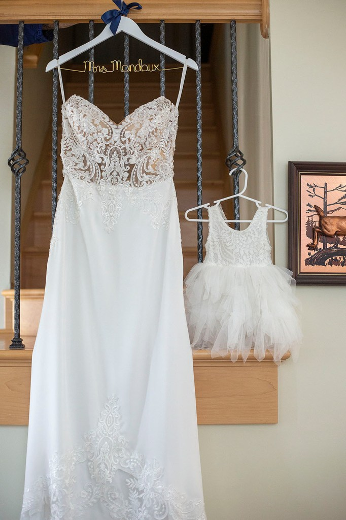 Bride's gown and her daughter, the flower girl's dress