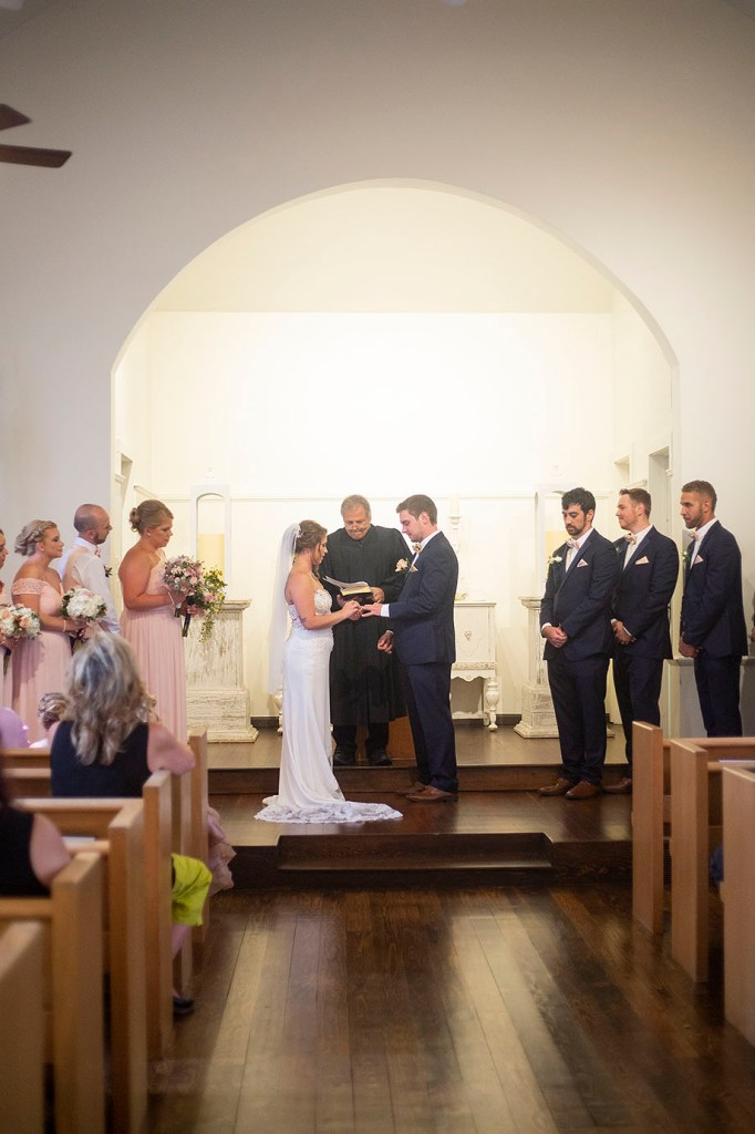 Exchanging of the rings at their Howell wedding