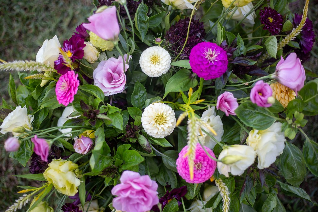 A floral arrangment in fuchsia and white