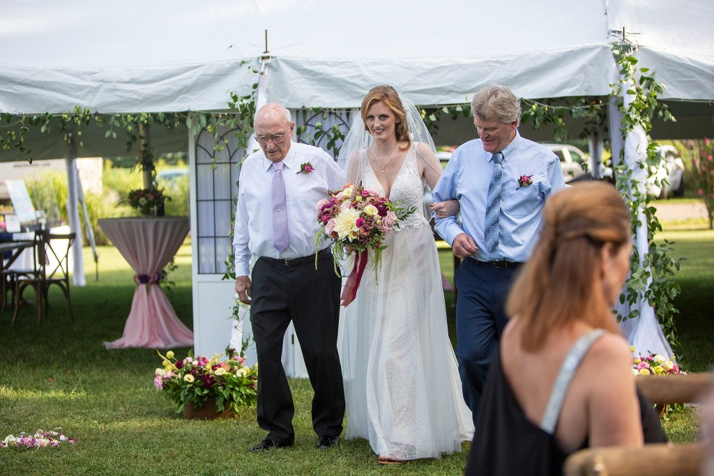 Bride, grandfather, and dad walking down the aisle