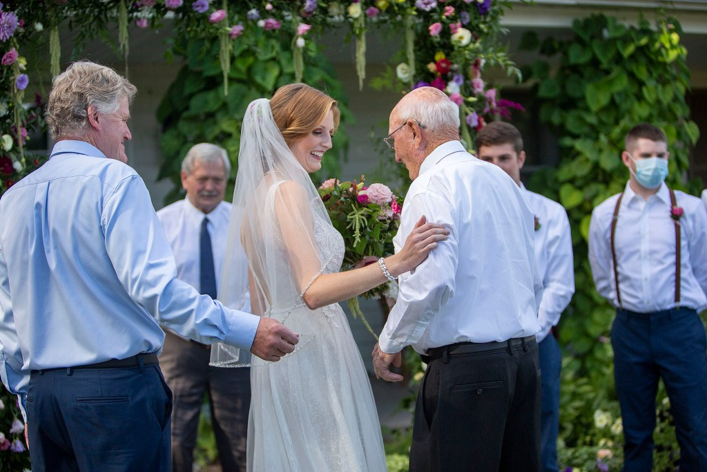 Bride getting handed off by grandfather