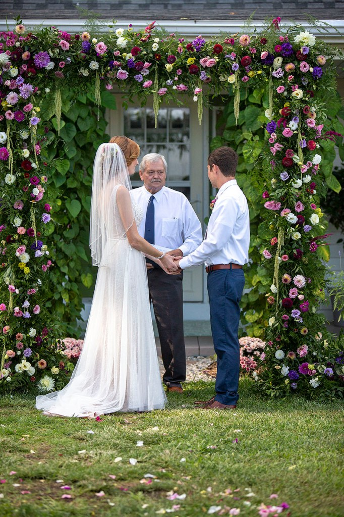 Couple exchanges vows with their uncle officiant