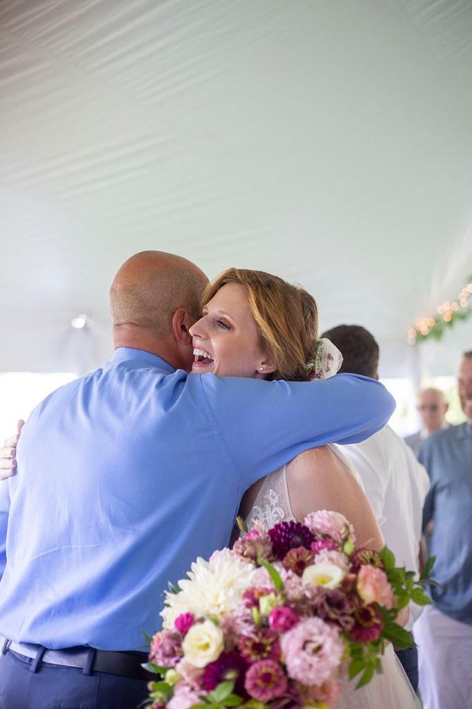 Bride hugs wedding guest
